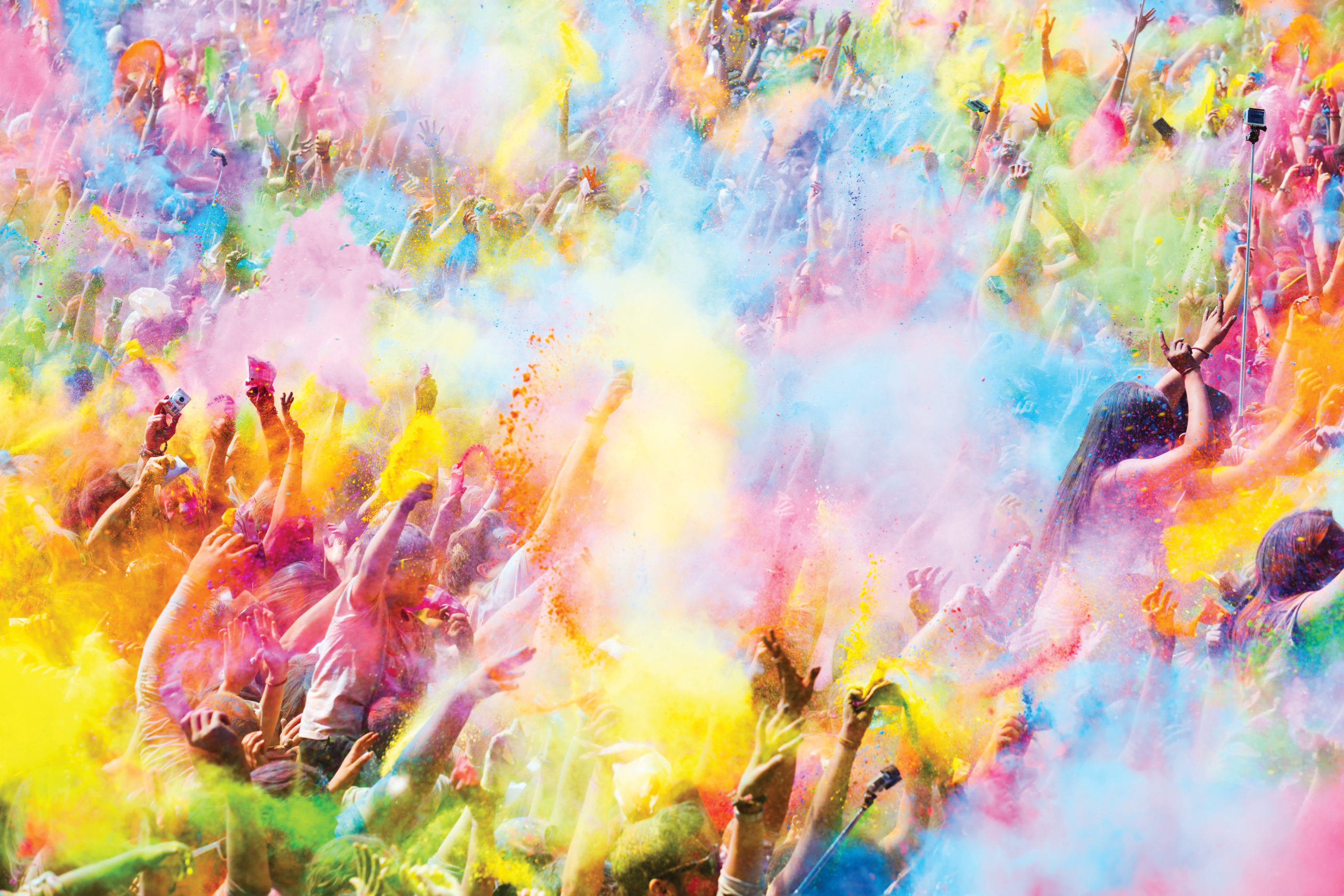 BARCELONA, SPAIN - APRIL 12, 2015: Happy people during Festival of colours Holi Barcelona. Holi is traditional holiday of India