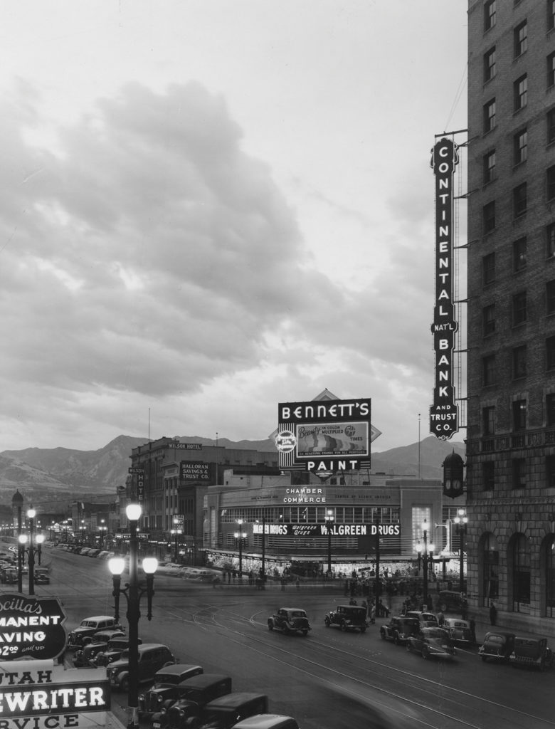 Main Street, including Bennett's Paint, Walgreen Drugs, Continental Bank and Trust Company and Wilson Hotel, 1938