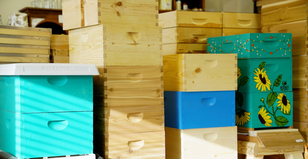 Assortment of beekeeping hive boxes at Deseret Hive Supply
